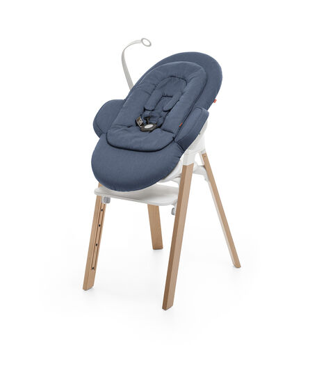 Bouncer, Blue. Mounted on Stokke Steps highchair. view 3
