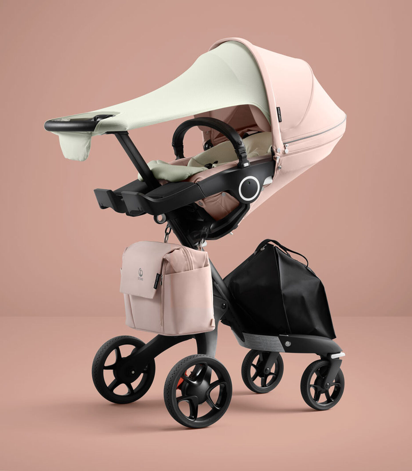 Stokke® Xplory® 6 Balance Limited Edition with Stokke® Stroller Seat. Soothing Pink. What's included: Seat textile, Seat Inlay, Sun Sail & Changing Bag. view 2