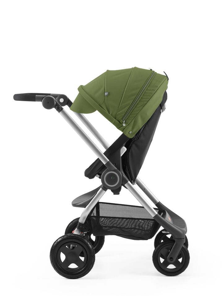 Stokke® Scoot™ Black with Green Canopy. Parent facing, active position.