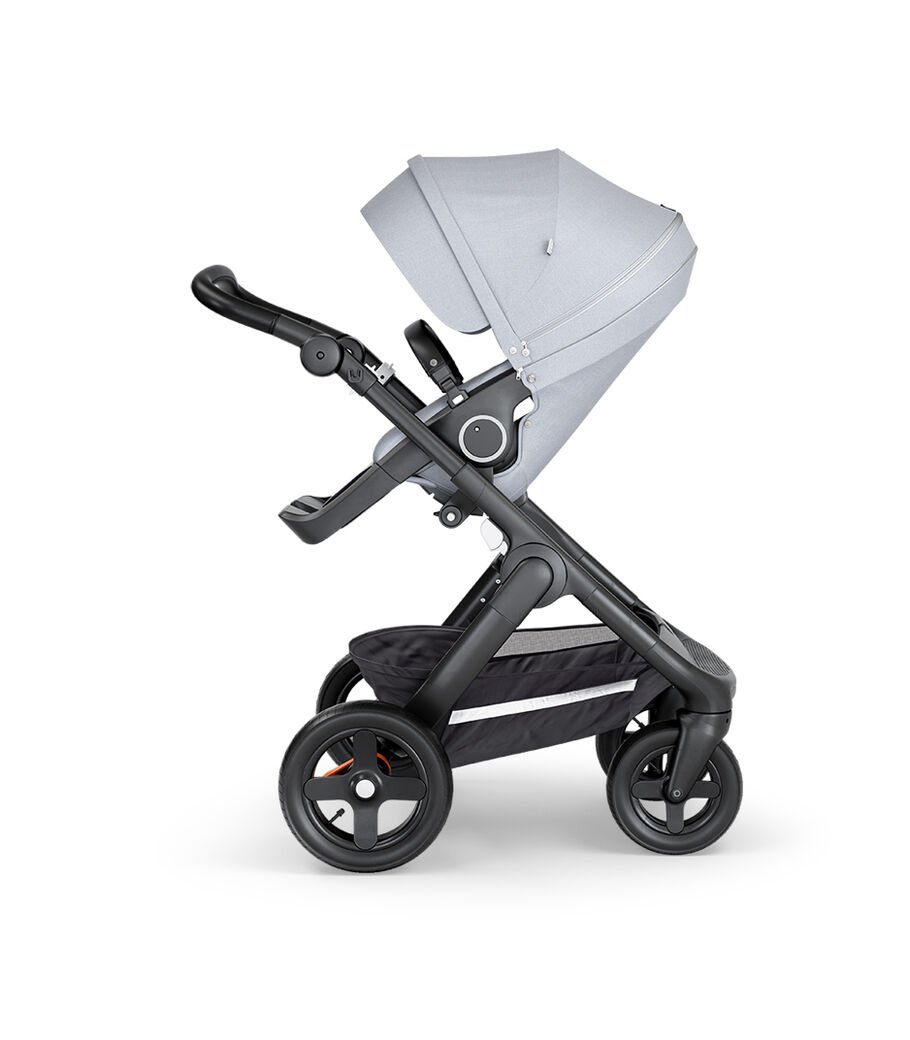 Stokke® Trailz™ with Black Chassis, Black Leatherette and Terrain Wheels. Stokke® Stroller Seat, Grey Melange.