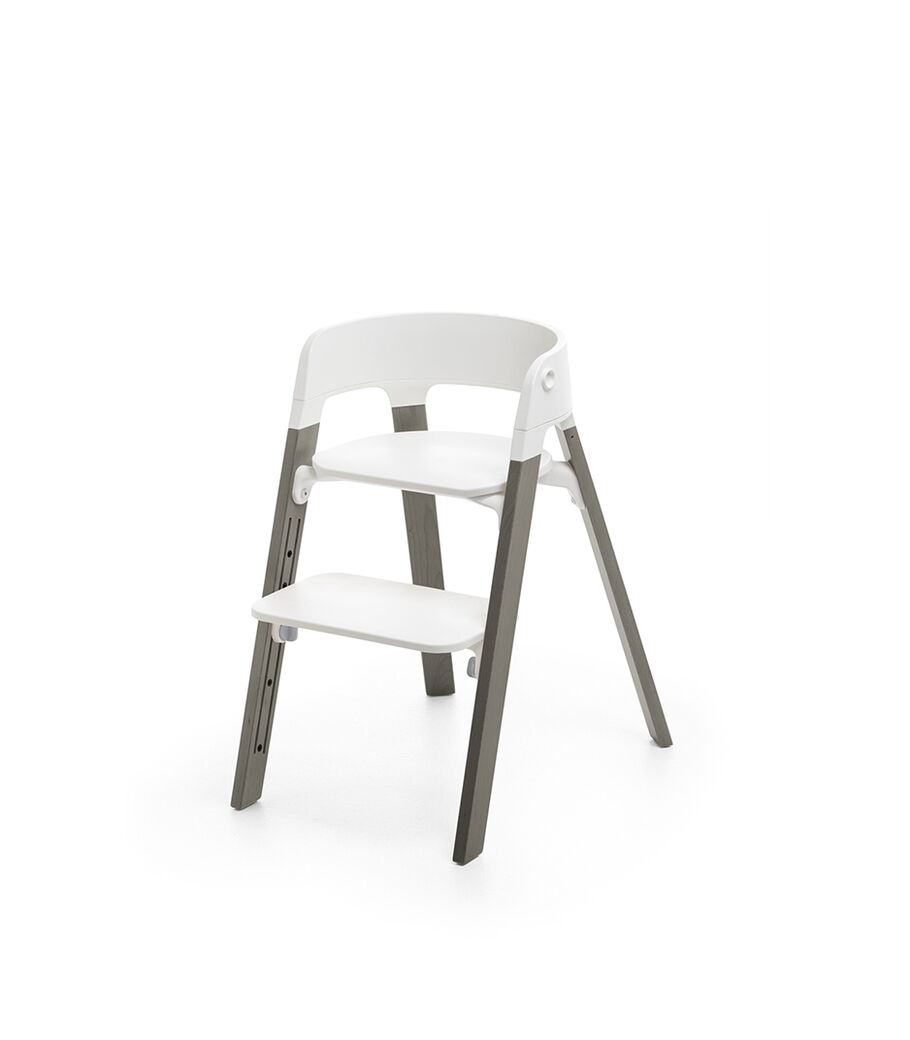 Stokke® Steps™ Hazy Grey  with white seat and footrest in high position. view 4