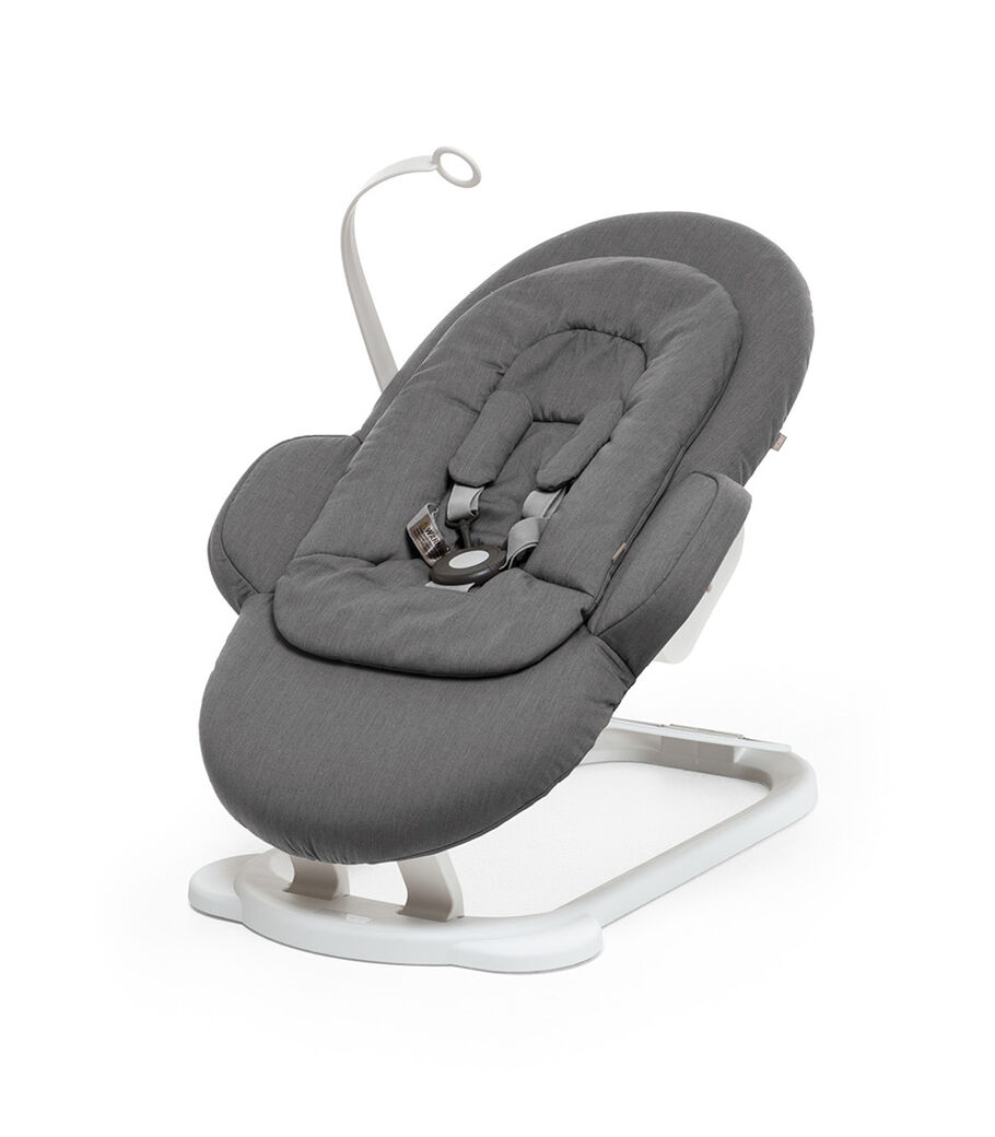 Stokke® Steps Bouncer in Deep Grey with White Base and Toy Hanger.