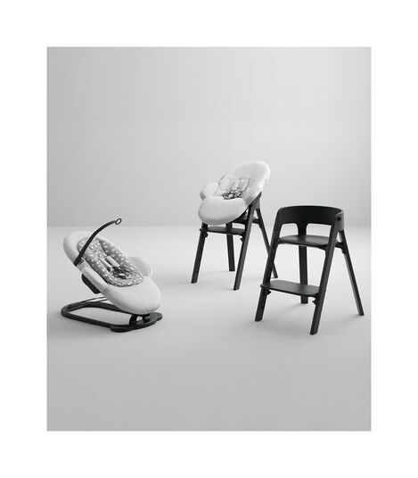 Stokke® Steps™ Bouncer with Grey Clouds textiles and highchair with Beech Black wood legs, Black seats. view 2
