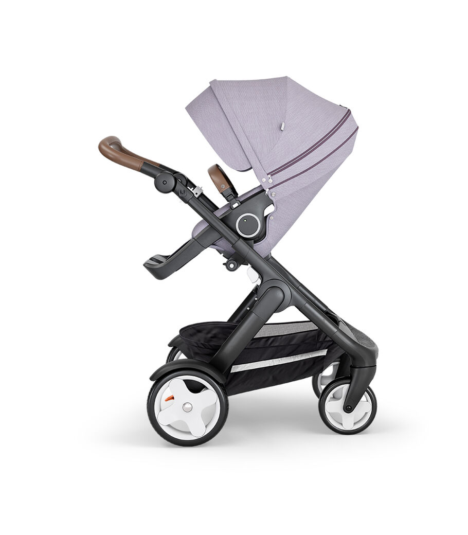 Stokke® Trailz™ with Black Chassis, Brown Leatherette and Classic Wheels. Stokke® Stroller Seat, Brushed Lilac. view 8