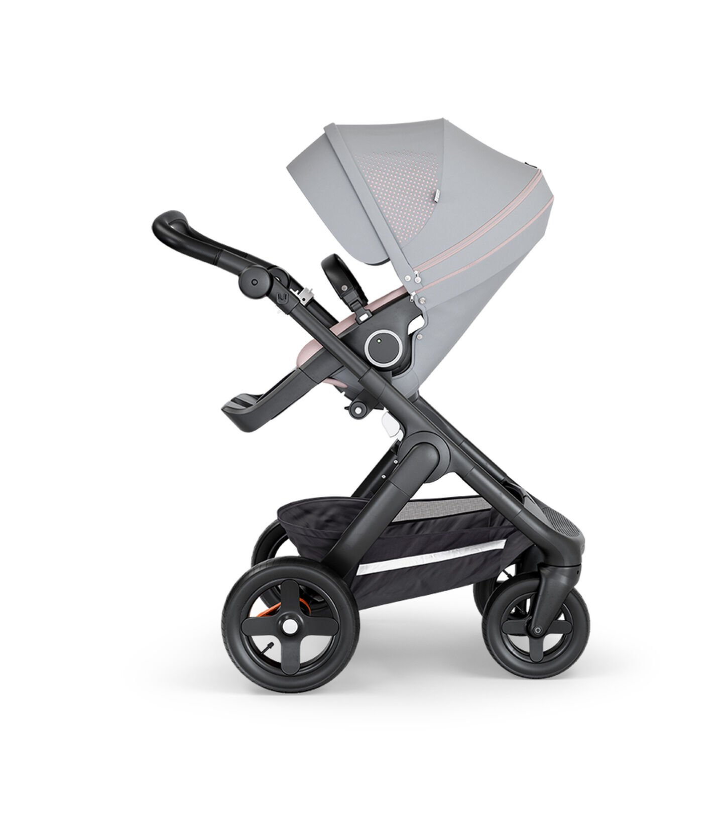 Stokke® Trailz™ with Black Chassis, Black Leatherette and Terrain Wheels. Stokke® Stroller Seat, Athleisure Pink.