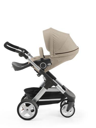 Stokke® Trailz™ with Stokke® Stroller Seat, parent facing, rest position. Beige Melange.