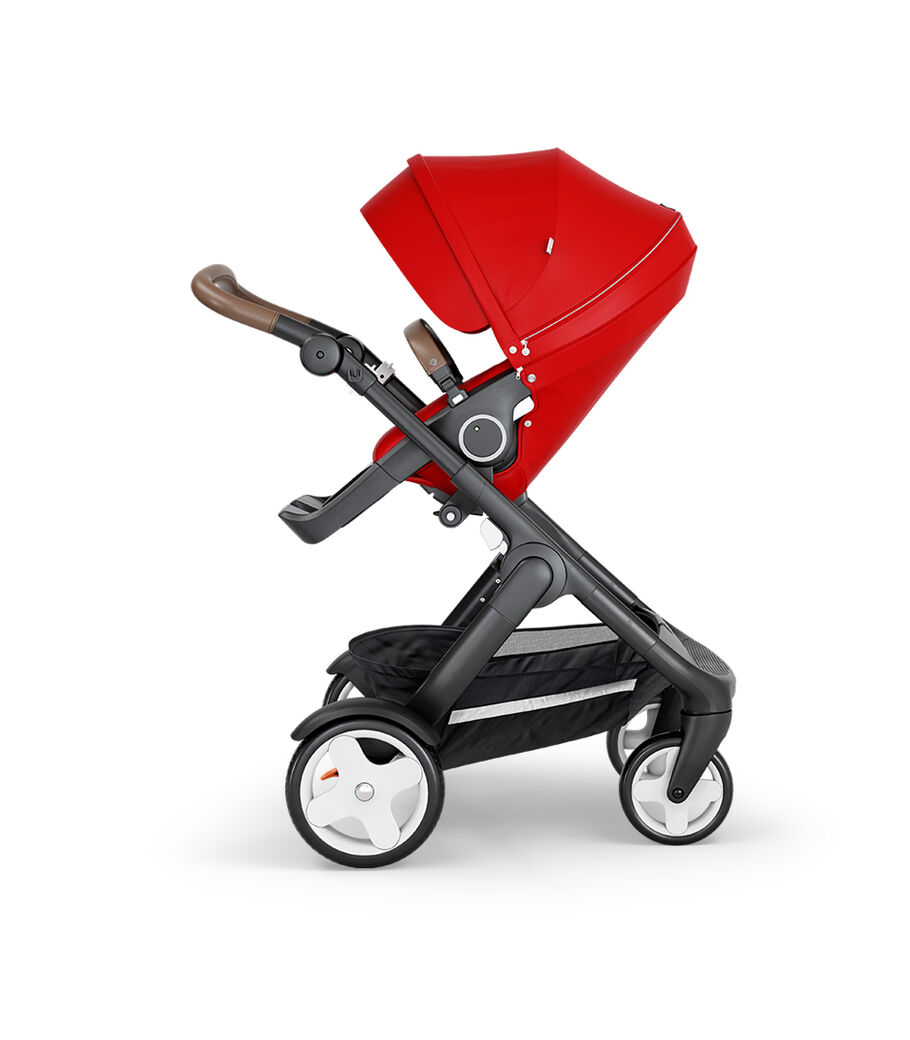 Stokke® Trailz™ with Black Chassis, Brown Leatherette and Classic Wheels. Stokke® Stroller Seat, Red.