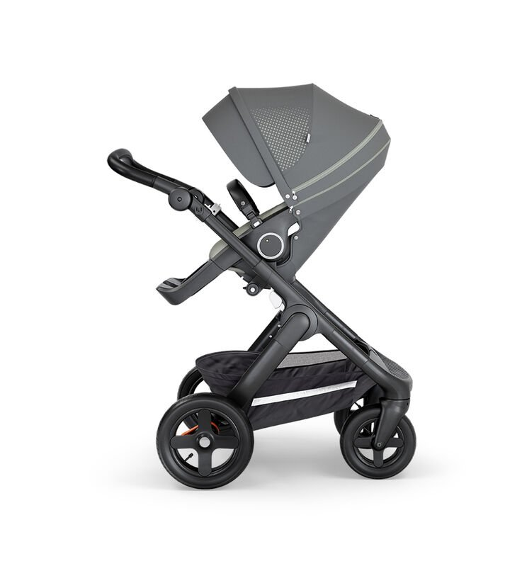 Stokke® Trailz™ with Black Chassis, Black Leatherette and Terrain Wheels. Stokke® Stroller Seat, Athleisure Green.