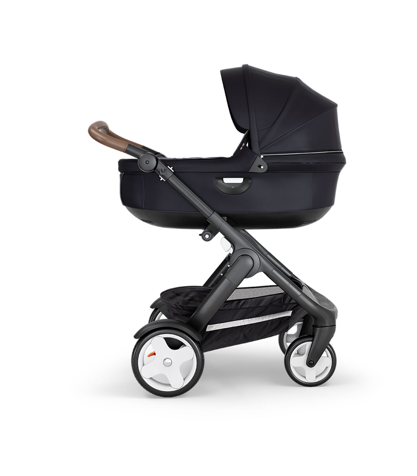 Stokke® Trailz™ with Black Chassis, Brown Leatherette and Classic Wheels. Stokke® Stroller Carry Cot, Black.