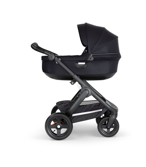 Stokke® Trailz™ with Black Chassis, Black Leatherette and Terrain Wheels. Stokke® Stroller Carry Cot, Black.