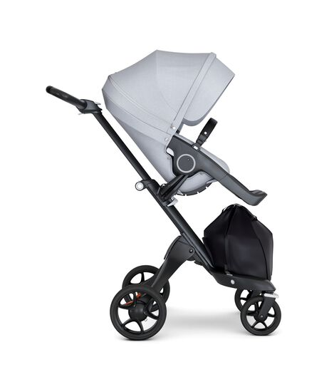 Stokke® Xplory® wtih Black Chassis and Leatherette Black handle. Stokke® Stroller Seat Seat Grey Melange. Forward facing.