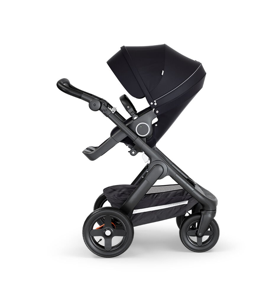 Stokke® Trailz™ with Black Chassis, Black Leatherette and Terrain Wheels. Stokke® Stroller Seat, Black.