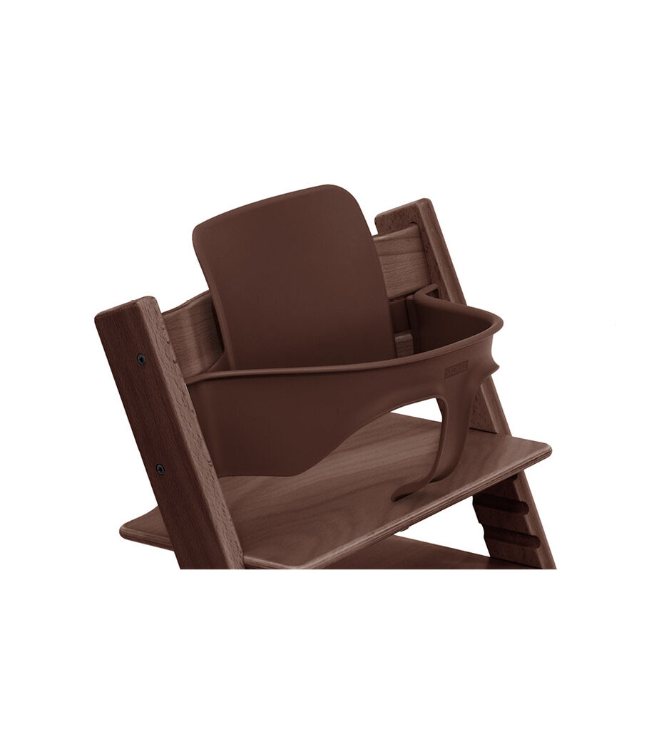 Tripp Trapp® Chair Walnut Brown with Baby Set. Close-up.