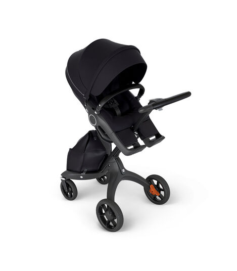 Stokke® Xplory® with Black Chassis and Leatherette Black handle. Stokke® Stroller Seat Black in angled view.