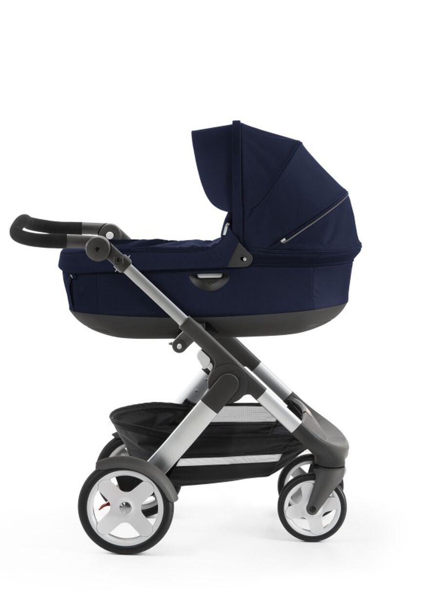 Stokke® Trailz™ with Stokke® Stroller Carry Cot, Deep Blue. Classic Wheels.