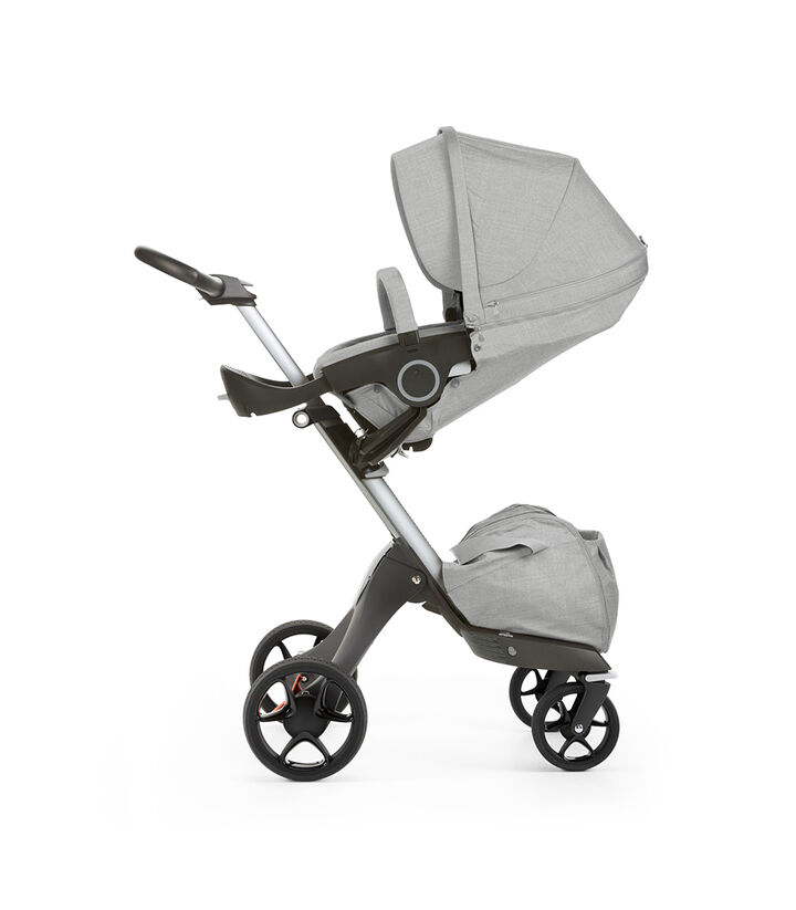 Stokke® Xplory® with Stokke® Stroller Seat, parent facing, sleep position. Grey Melange. New wheels 2016. view 1