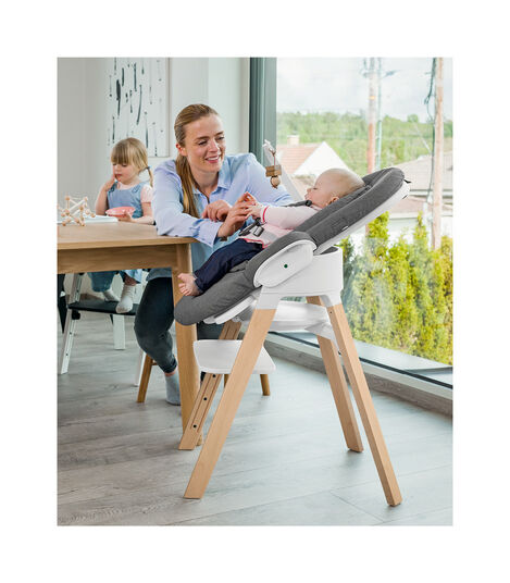 Stokke® Steps™ high chair. Beech Natural with White seat. Bouncer Deep Grey.