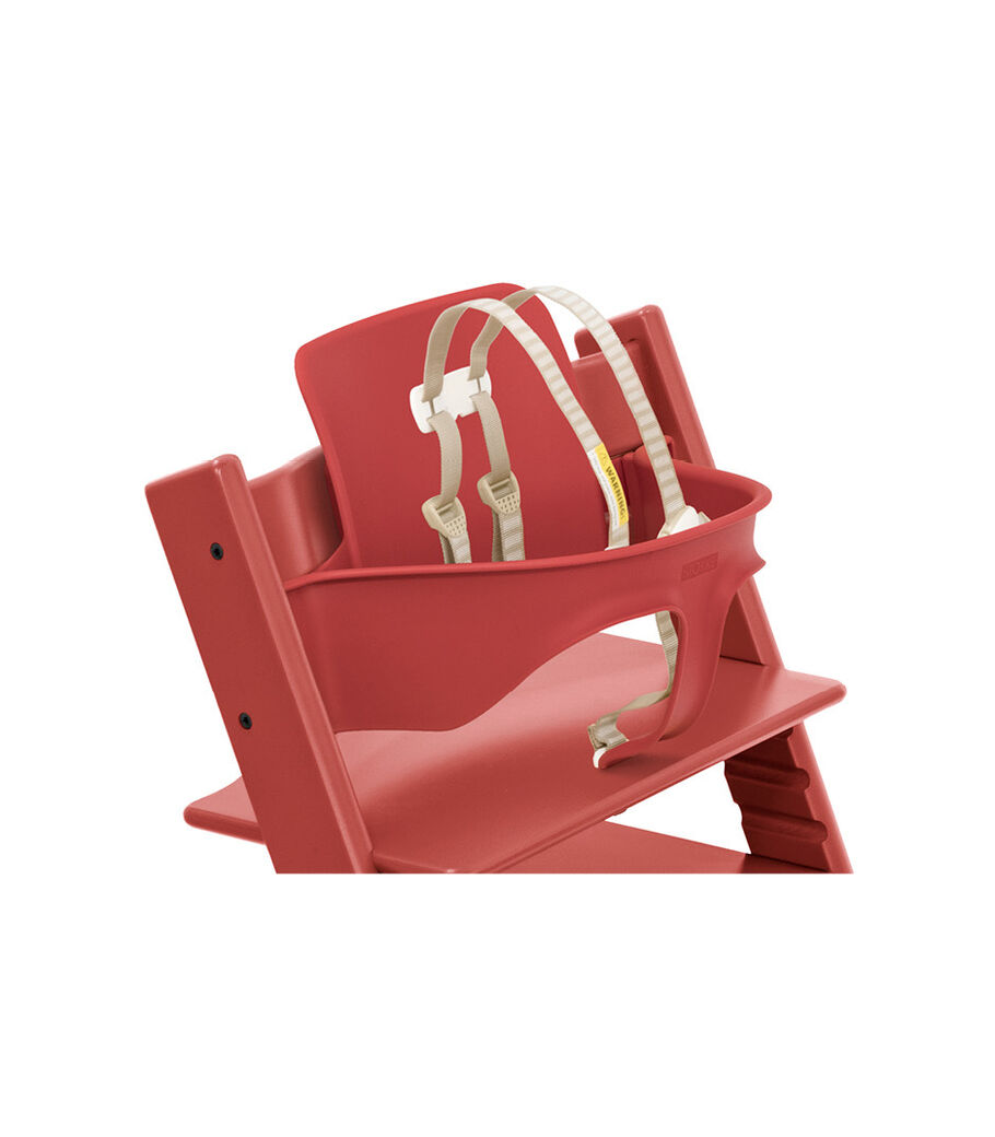 Tripp Trapp® Chair Warm Red with Baby Set. Close-up. US with Harness.