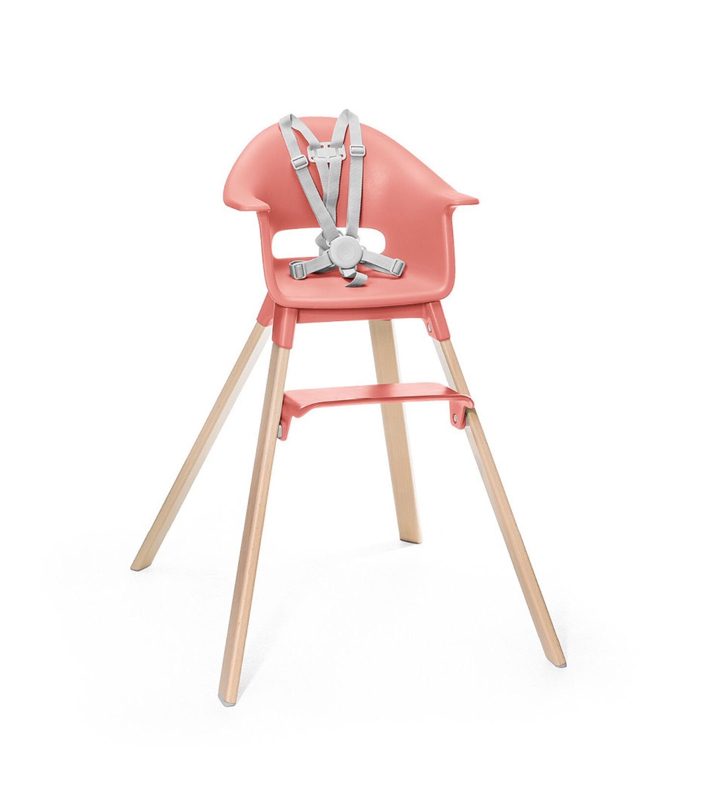 Stokke® Clikk™ High Chair. Natural Beech wood and Sunny Coral plastic parts. Stokke® Harness attached. Footrest low.