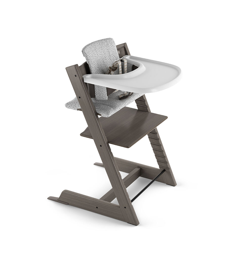 Tripp Trapp® Chair and Baby Set in Hazy Grey with Classic Cushion Cloud Sprinkle and Stokke Tray White. 3D rendering. US version.