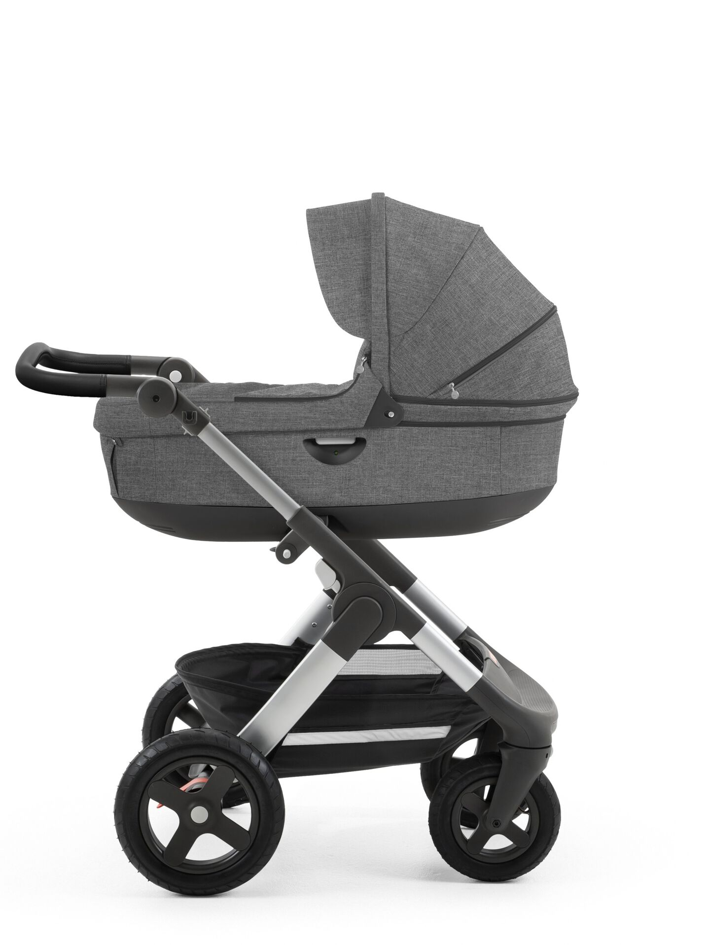 Stokke® Trailz™ with silver chassis  and Stokke® Stroller Carry Cot, Black Melange. Leatherette Handle.