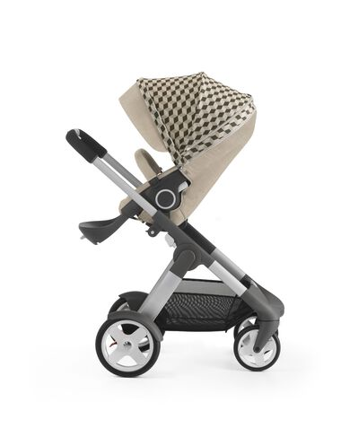Stokke® Crusi™ with Stokke® Stroller Seat and Beige Cube Style Kit.