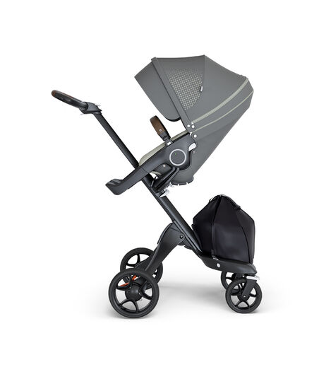 Stokke® Xplory® wtih Black Chassis and Leatherette Brown handle. Stokke® Stroller Seat Athleisure Green.