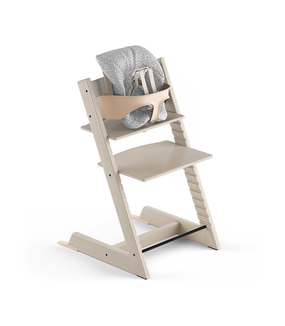 Tripp Trapp® Whitewash, Beech. With Tripp Trapp® Baby Set and Baby Cushion Cloud Sprinkle. US version with Harness.