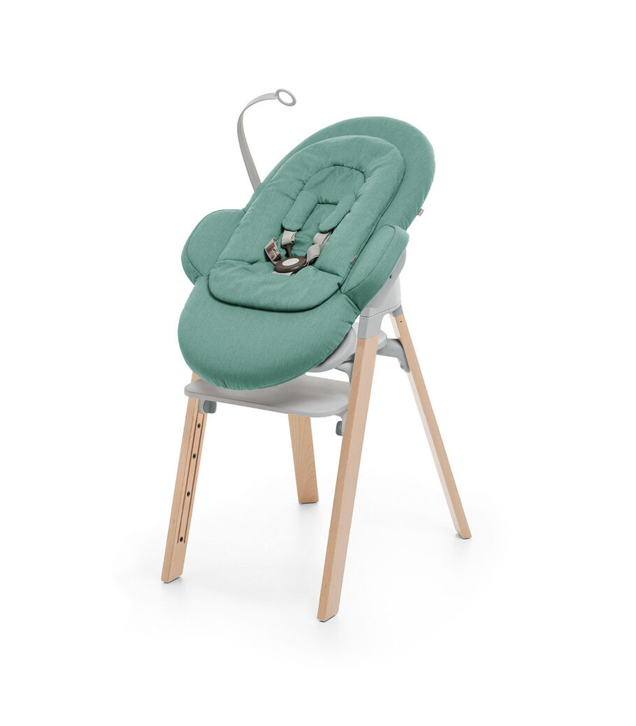 Stokke® Steps™ Natural and Light Grey plastic with Stokke® Steps Bouncer in Cool Jade.