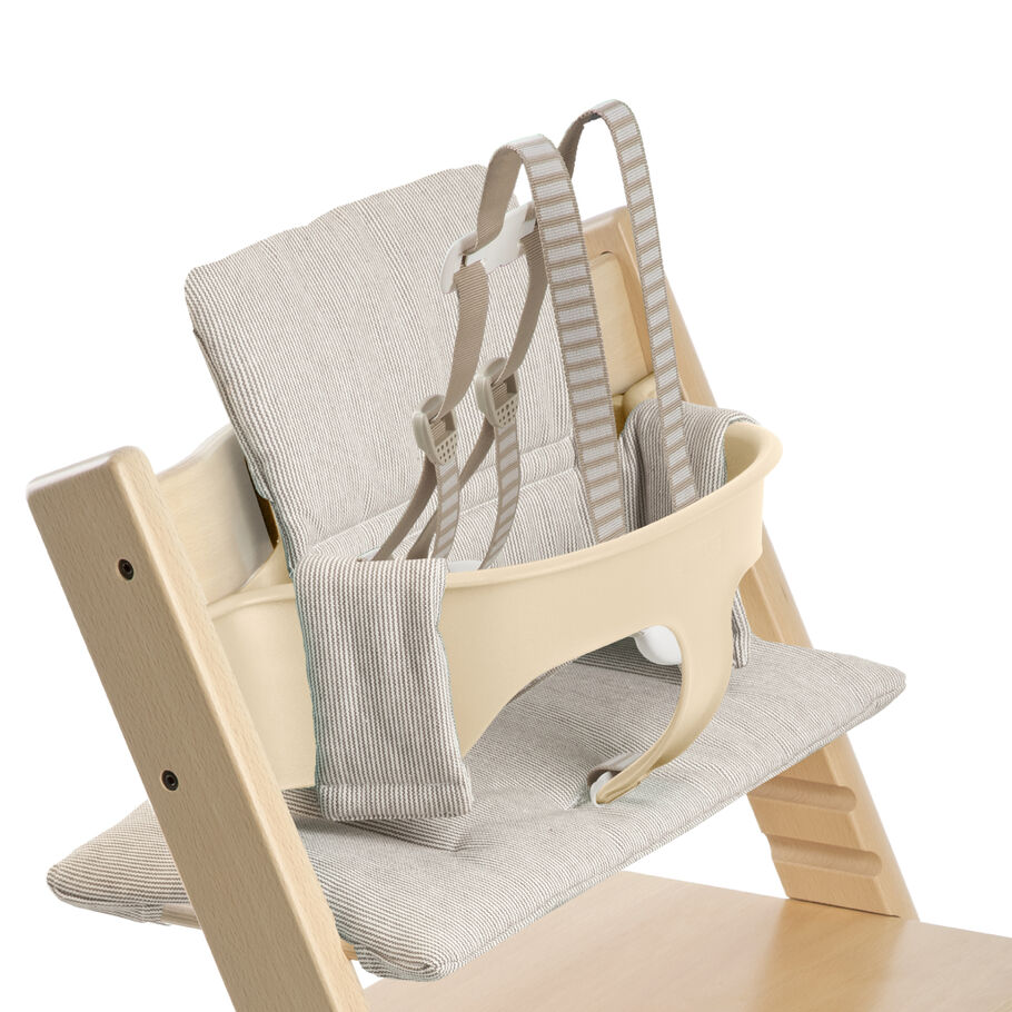 Tripp Trapp® Natural with Baby Set and Grey Loom cushion. US version. Detail.