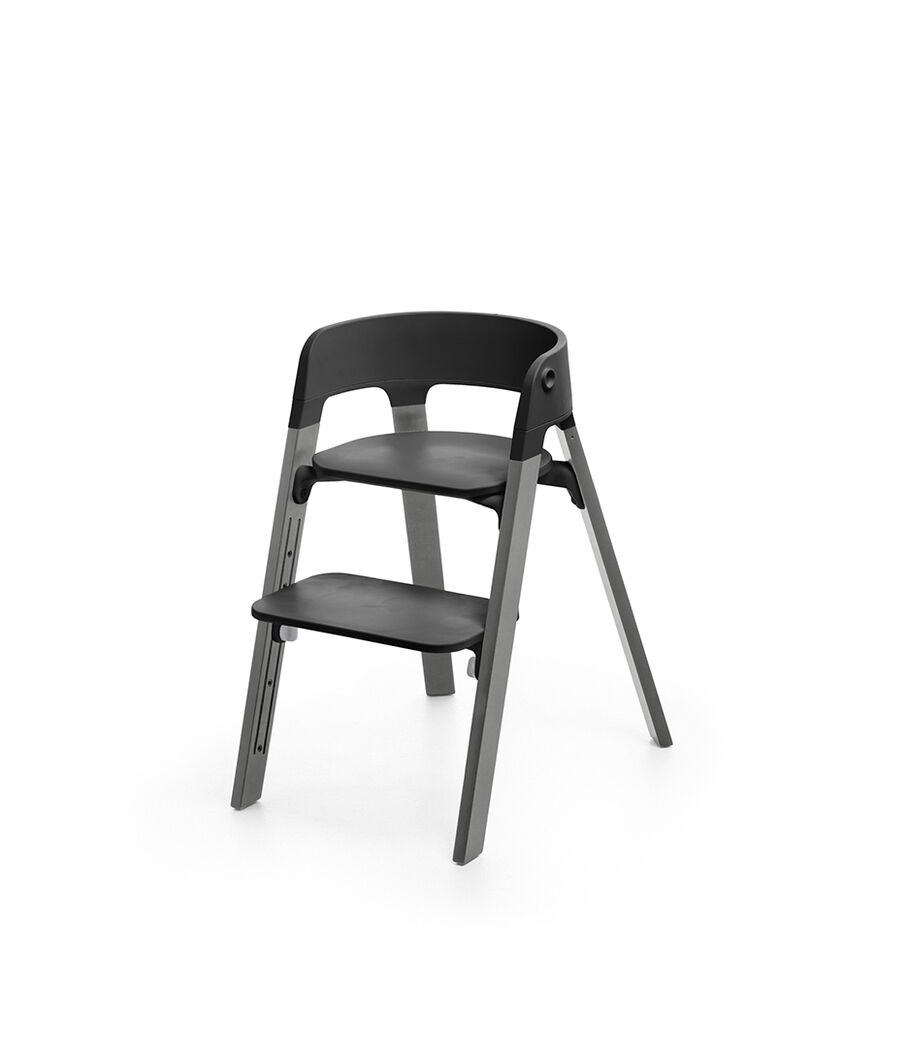 Stokke® Steps™ Storm Grey  with Black seat and footrest in high position.