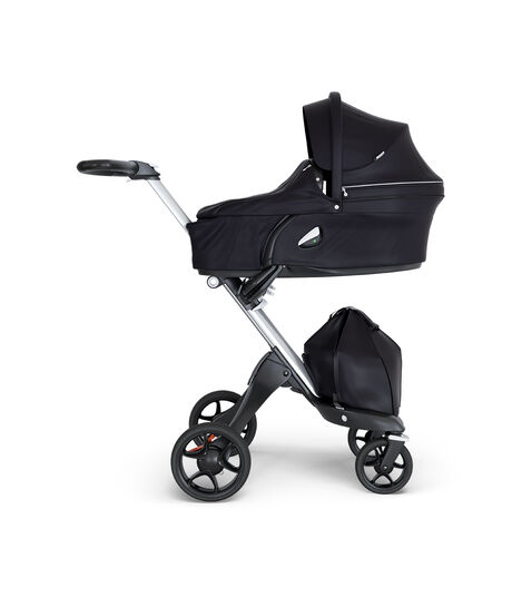 Stokke® Xplory® wtih Silver Chassis and Leatherette Black handle. Stokke® Stroller Carry Cot Black. view 2