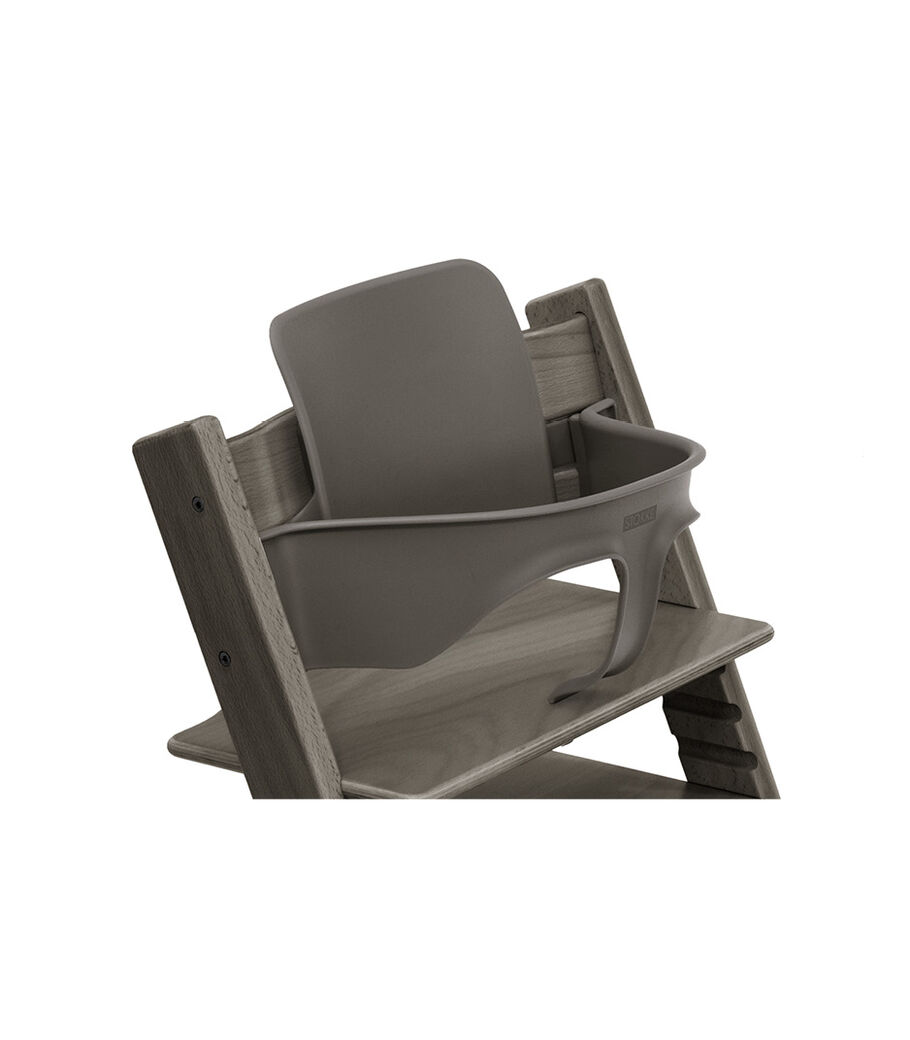 Tripp Trapp® Chair Hazy Grey with Baby Set. Close-up.