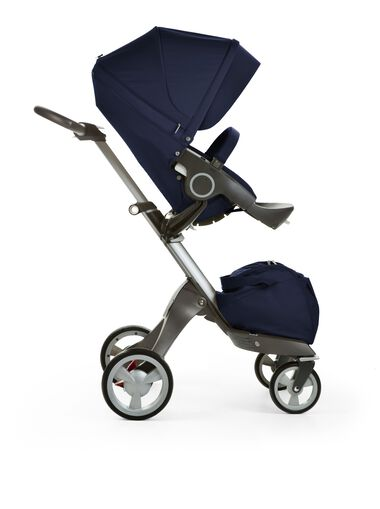 Stokke® Xplory® with Stokke® Stroller Seat, Deep Blue. Stroller with baby in the….