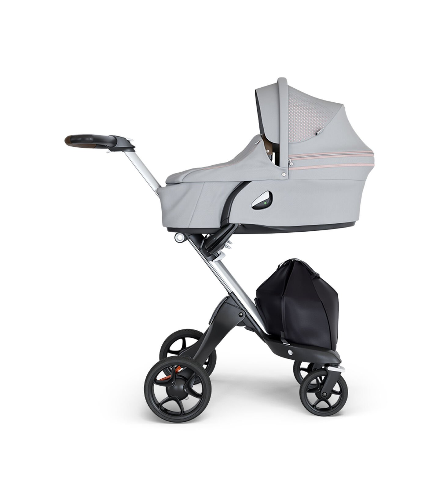 Stokke® Xplory® wtih Silver Chassis and Leatherette Brown handle. Stokke® Stroller Carry Cot Athleisure Pink.