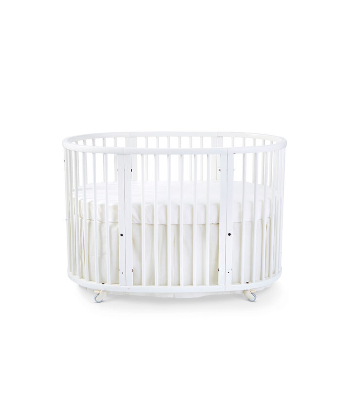 Stokke® Sleepi™ Bed, White. Bed Skirt Natural. US only.