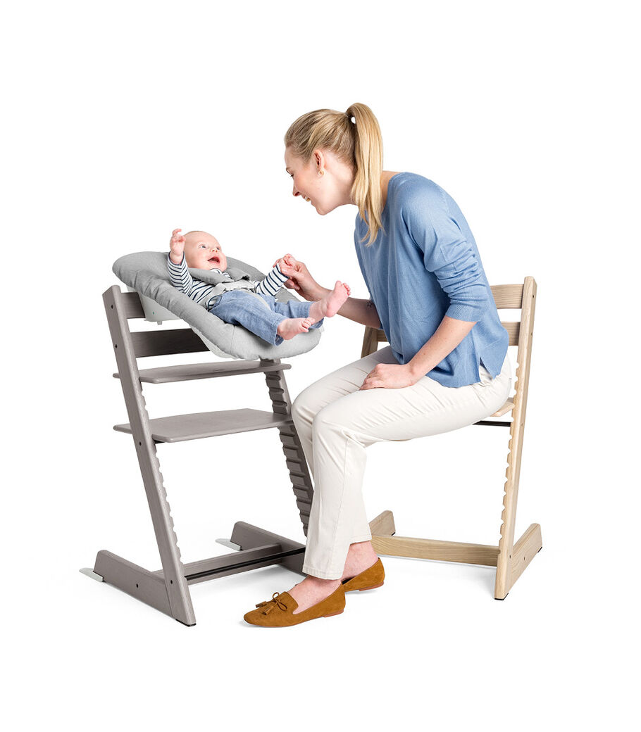 Tripp Trapp® and Tripp Trapp® Newborn Set in setting. Natural and Oak Greywash. view 2