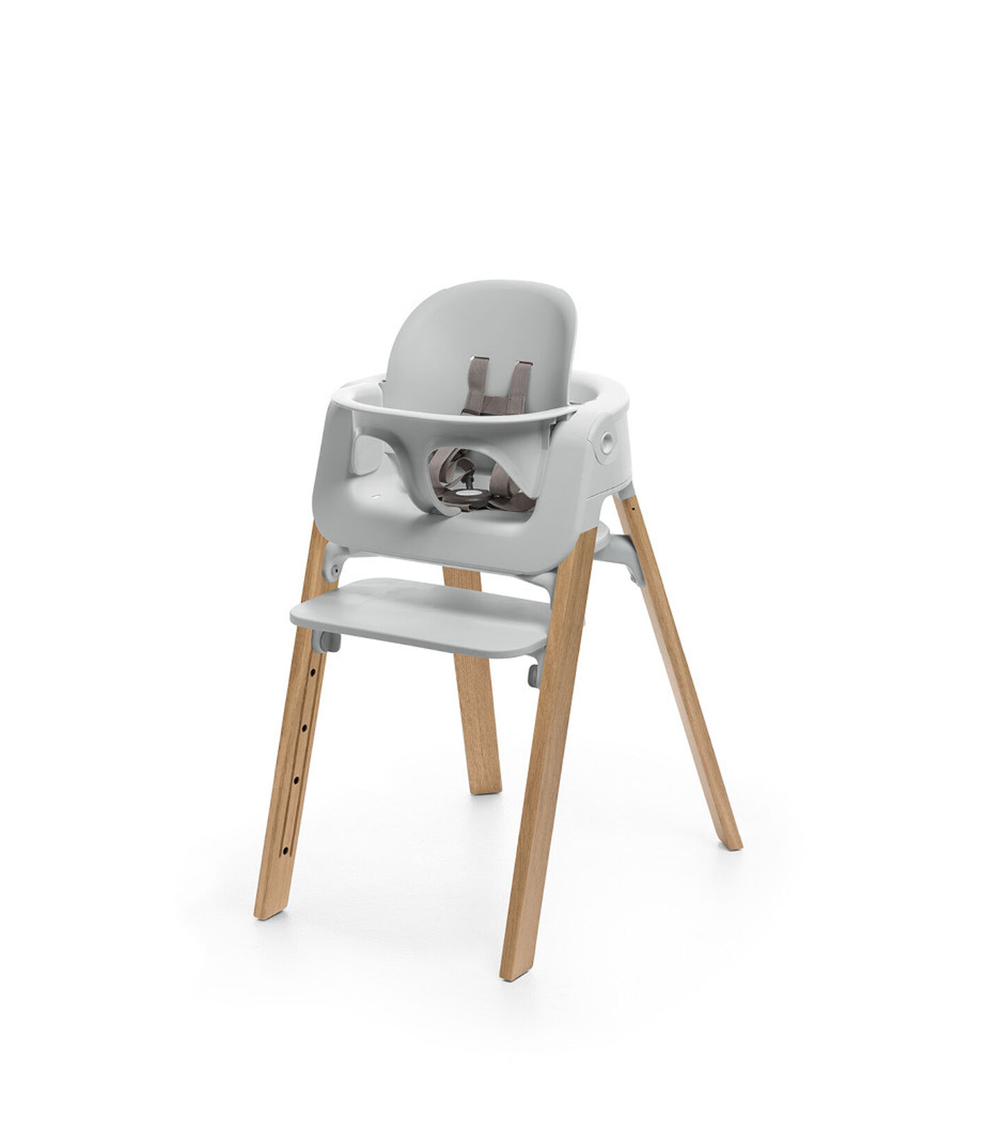 Stokke® Steps™ Oak Natural chair with Baby Set Light Grey.