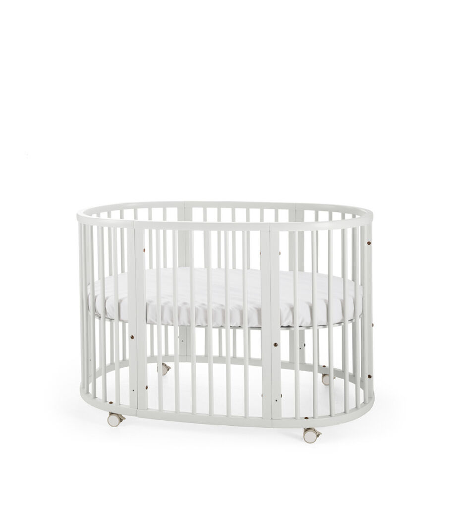 Stokke® Sleepi™ Bed. White. Mattress high.