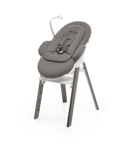 Bouncer, Greige. Mounted on Stokke Steps highchair. view 7