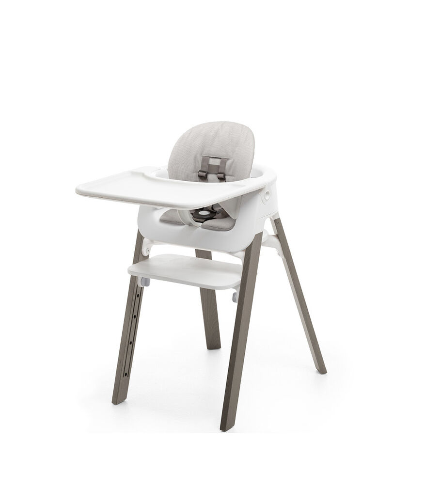 Stokke® Steps™ Hazy Grey with Accessories. Baby Set White. Baby Set Cushion Timeless Grey. Baby Set Tray White.