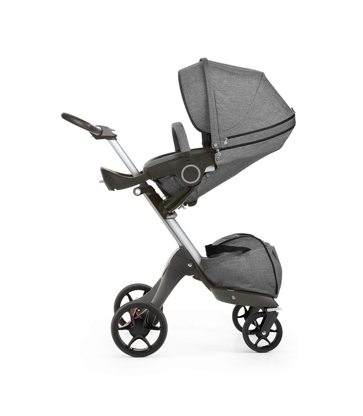 Stokke® Xplory® with Stokke® Stroller Seat, parent facing, sleep position. Black Melange. New wheels 2016.