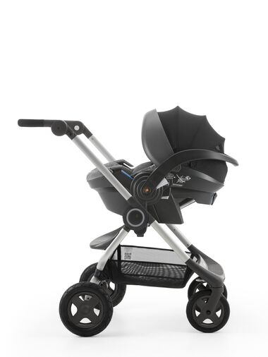 Stokke® iZi Go Modular™ by Besafe®, Black Melange. Mounted on Stokke® Scoot™.