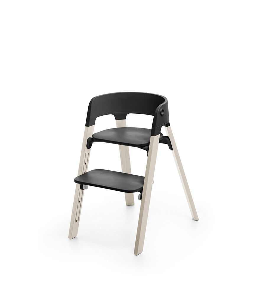 Stokke® Steps™ Whitewash with Black seat and footrest in high position. view 11