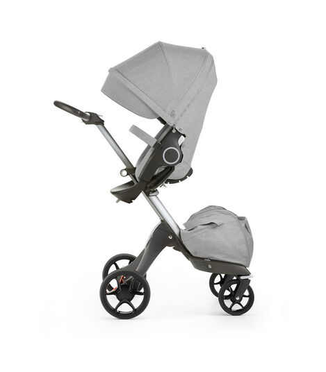 Stokke® Xplory® with Stokke® Stroller Seat, parent facing, active position. Grey Melange. New wheels 2016.
