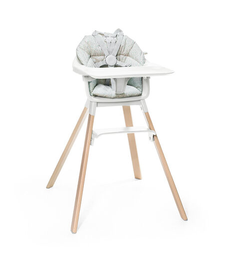 Stokke® Clikk™ High Chair. Natural Beech wood and White plastic parts including Tray. Cushion Grey Sprinkle and Harness.