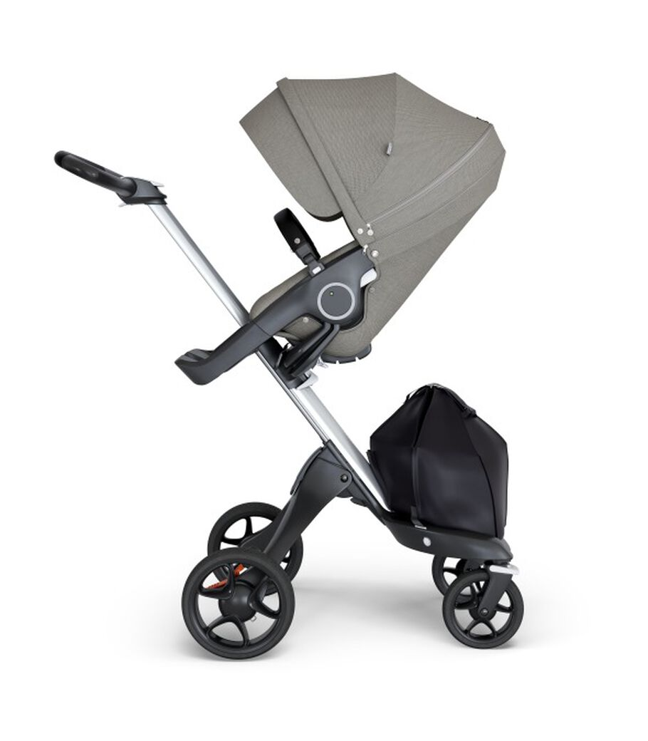 Stokke® Xplory® wtih Silver Chassis and Leatherette Black handle. Stokke® Stroller Seat Seat Brushed Grey. view 12