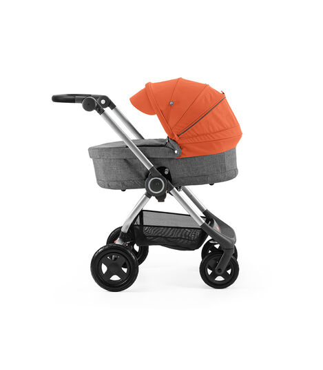 Stokke® Scoot™ with Carry Cot Black Melange and Orange Canopy.