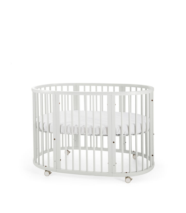 Stokke® Sleepi™ Bed. White. Mattress high. view 1