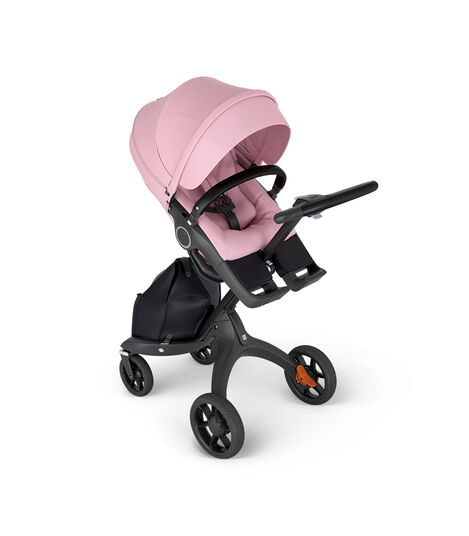 Stokke® Xplory® with Black Chassis and Leatherette Black handle. Stokke® Stroller Seat Lotus Pink in angled view.